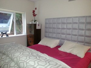 Photo supplied by a Happy Customer. Cubed Headboard shown in suede fabric.