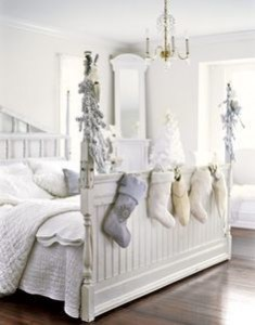 Add Christmas stockings to end of bed